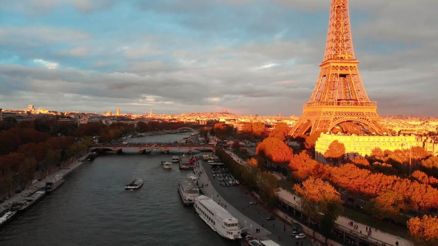 Aerial drone view of Paris Eiffel Tower Tour de Eiffel and panoramic view over Seine River and Paris city attractions at sunset    Shutterstock HD Video #1053482615