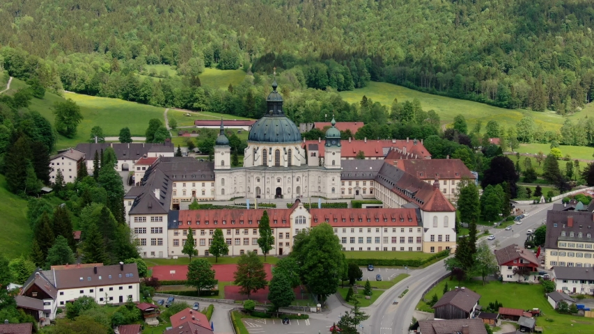 Ettal Abbey, called Kloster Ettal, a monastery in the village of Ettal, Bavaria, Germany - aerial photography | Shutterstock HD Video #1053488738