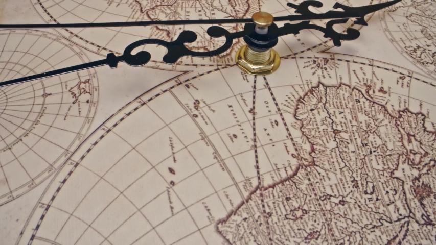 Antique world map clock running - sliding and rotating macro close up shot, 4k   Shutterstock HD Video #1053492980