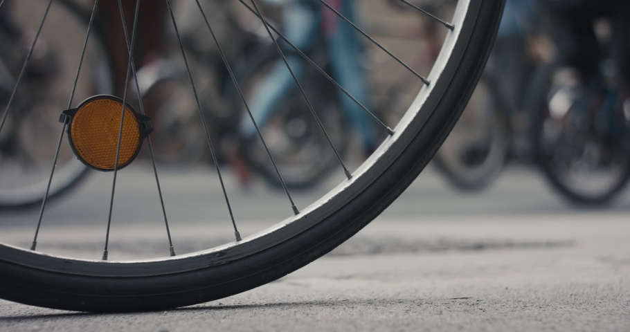Bicycle wheels on political protests on bikes against for protection of nature in Europe during virus pandemic | Shutterstock HD Video #1053499088