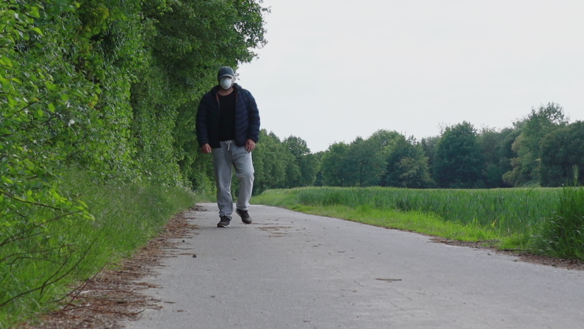 Man walking alone observing the rules of distance | Shutterstock HD Video #1053501782