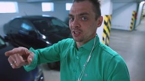 A video blogger gives an overview on the topic of cars in a garage. A form of transmitting information through video, the exchange of information. Online review and buying cars in a social distance.