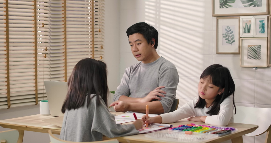 Upset daughter looking at working father, Busy asian business man speaking looking at laptop computer communicating by video call at home ignoring loving daughter. lack of family communication concept   Shutterstock HD Video #1053506366