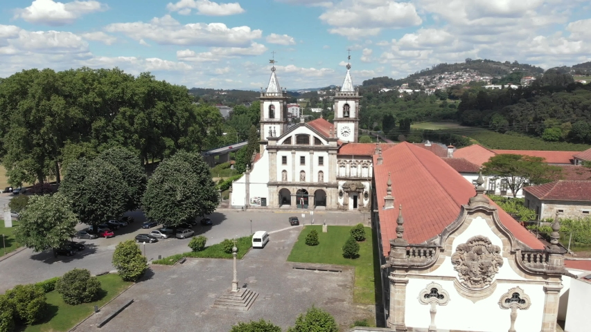 AERIAL DRONE FOOTAGE - The Monastery of St. Benedict (Sao Bento) in the city of Santo Tirso, Portugal, with the Ave River in the background. Benedictine order. | Shutterstock HD Video #1053509504