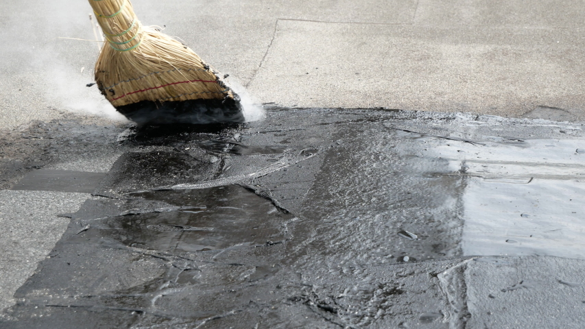 Roof repair, fill cracks with tar with a broom. Fill cracks in the roof tar, a partial roof repair. | Shutterstock HD Video #1053511727