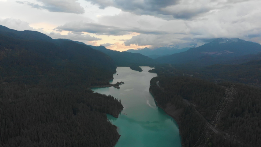 Flying over the mountains and forest in rural British Columbia. Aerial shot, pull back, panorama.