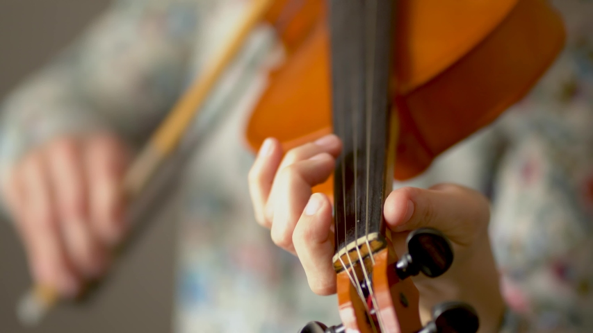 Musician playing the violin. Hands of musician, close up view. Front view. | Shutterstock HD Video #1053522860