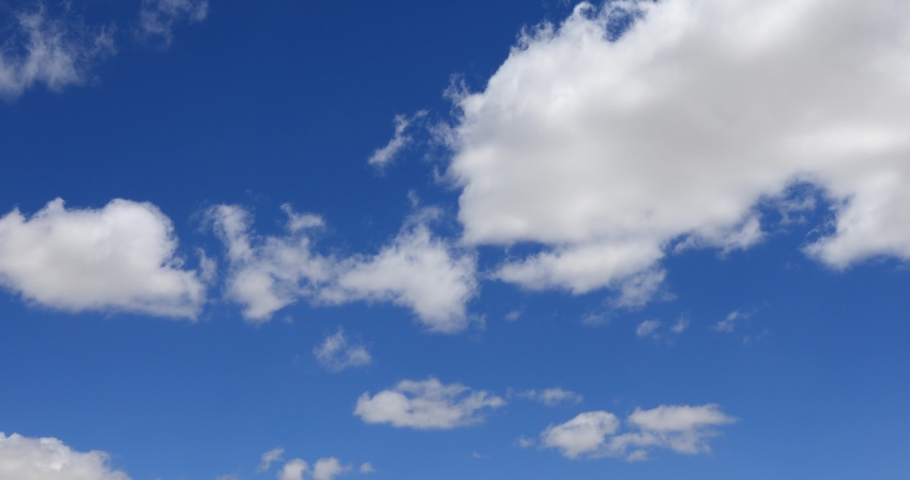 Cumulus clouds form against brilliant Blue skies sky Royalty-Free Stock Footage #1053529181