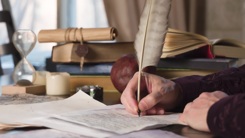 Medieval Writer Corrects the Text. Medieval writer rereads text on a sheet of old paper and appends with a pen at the bottom a few lines | Shutterstock HD Video #1053530141
