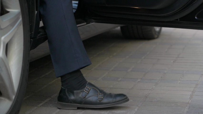 The man gets out of the car black businessman legs closeup slow motion | Shutterstock HD Video #1053530993