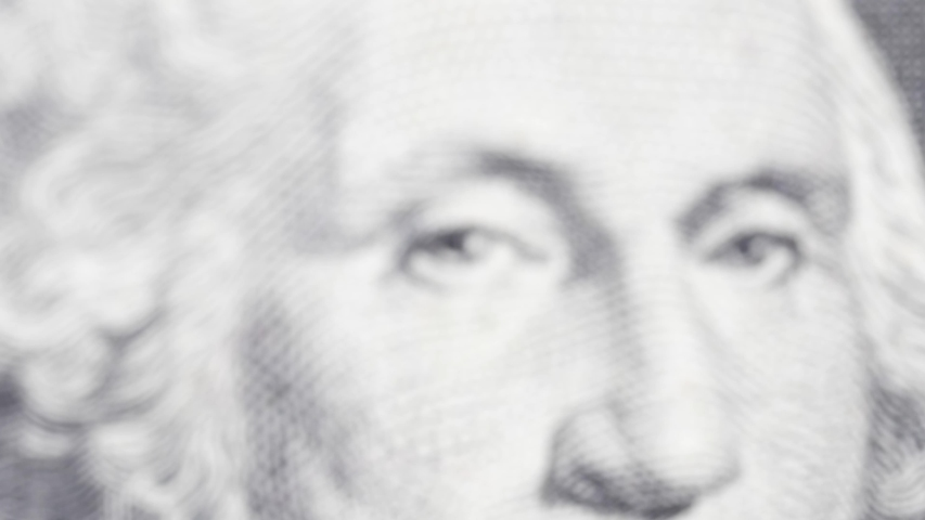 One dollar with president George Washington in macro for business or financial video | Shutterstock HD Video #1053531083