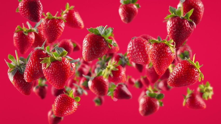 Flying Strawberry in Fuchsia Background Royalty-Free Stock Footage #1053531500