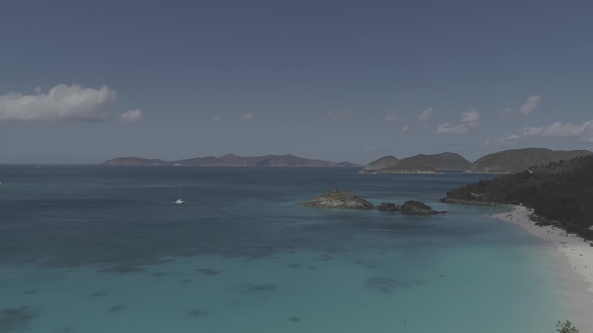 Aerial shot of US Virgin Islands. Sea, waves, rocks, palm trees, trees, coastal hoarfrost, islands, sand, crabs, textured sky, landscape, nature, drone video.