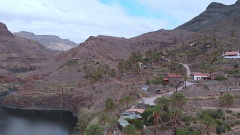 Beautiful lake ayagaures of gran canaria in Spain. Landscape with lake, mountains and overcast sky