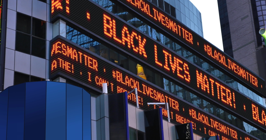 "A Times Square stock market ticker displays the ""Black Lives Matter"" and ""I Can't Breathe"" statements. These phrases were commonly heard in protests after the killing of George Floyd by police in MN. 