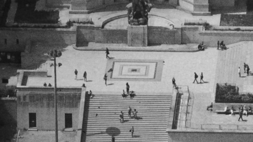 VHS vintage tape effect of aerial view of unrecognizable people tourists sightseeing walking in Trocadero Gardens in Paris France - Aerial view of busy touristic landmark