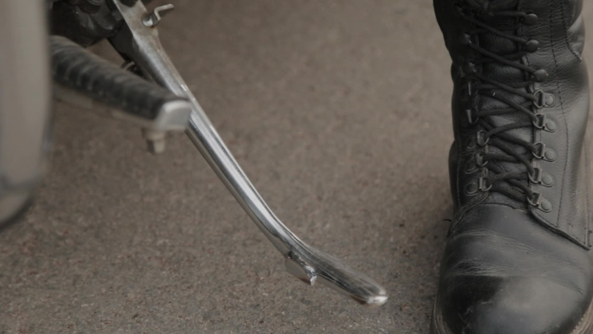 Male biker on a motorcycle getting ready to ride. | Shutterstock HD Video #1053570044