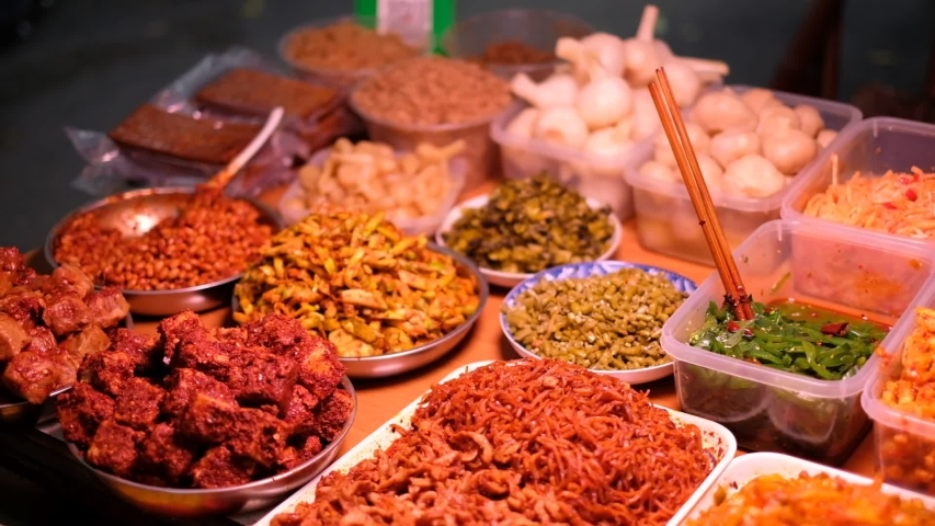 Chinese snacks. Pickled Garlic. Asparagus. Spicy pepper. Beans The national food of China. Spicy food. Pickled vegetables. The market for goods.