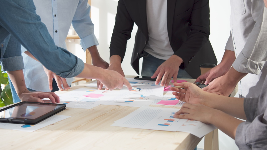 Close up Hands of asian creative employee standing and brainstorming stategy plan in happy workshop at creative workplace. Effective meeting, productive workshop and synergy business concept Royalty-Free Stock Footage #1053576725