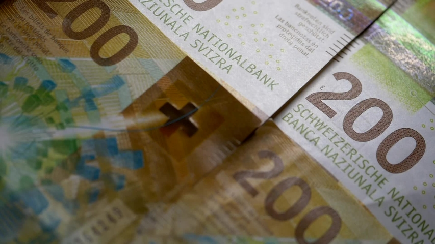 Close up shot of Swiss Money two hundred Chf francs,detail Banknotes | Shutterstock HD Video #1053577418