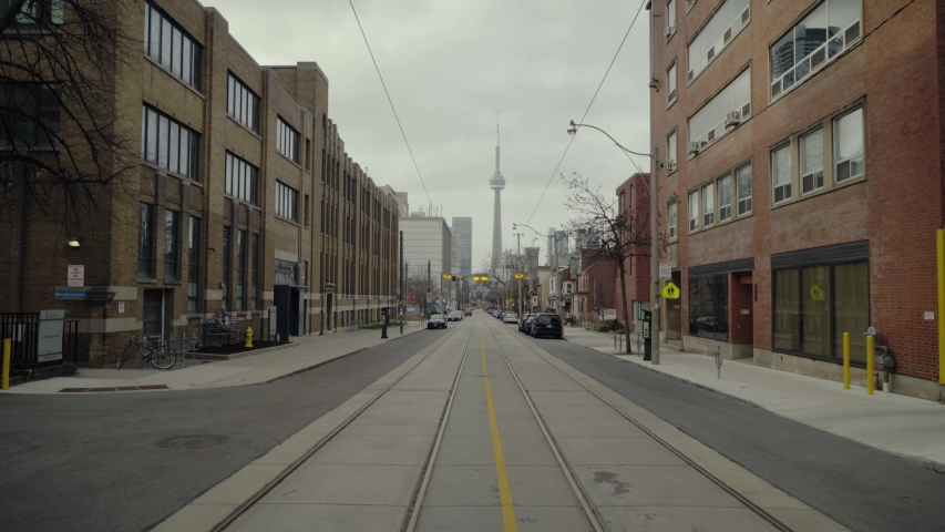 Empty street in downtown Toronto during the Covid19 Coronavirus Quarantine. CN Tower in the distance, looks like a ghost Town. Royalty-Free Stock Footage #1053577433