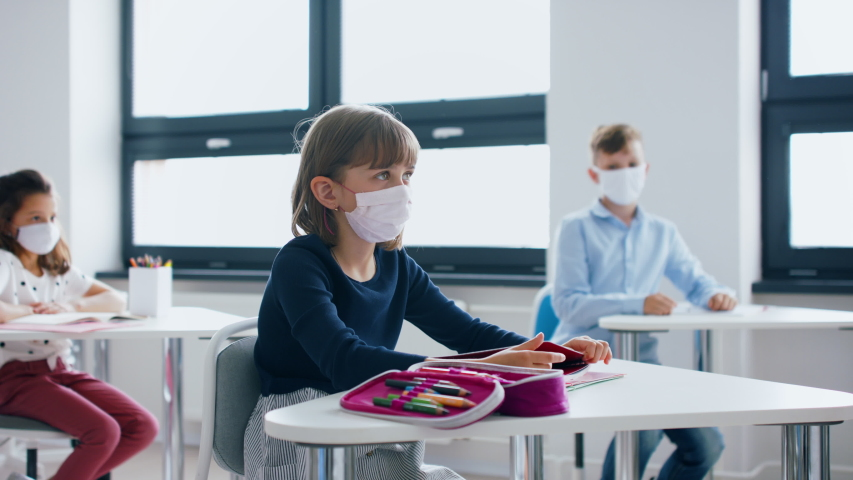Group of children with face mask back at school after covid-19 quarantine and lockdown. Royalty-Free Stock Footage #1053578885