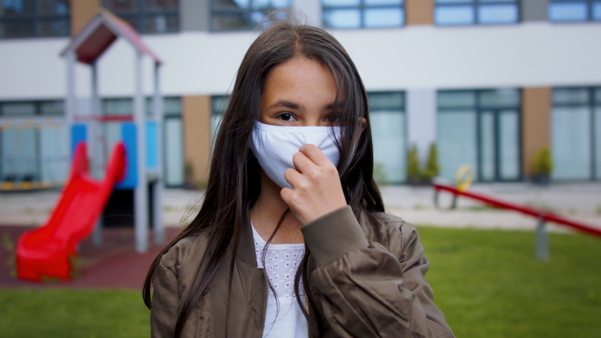 Portrait of happy child with face mask going back to school after covid-19 lockdown. Royalty-Free Stock Footage #1053579110