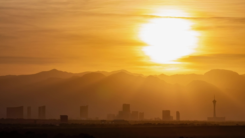 Sunset time lapse of the beautiful strip skyline with red clouds at Las Vegas, Nevada   Shutterstock HD Video #1053580034