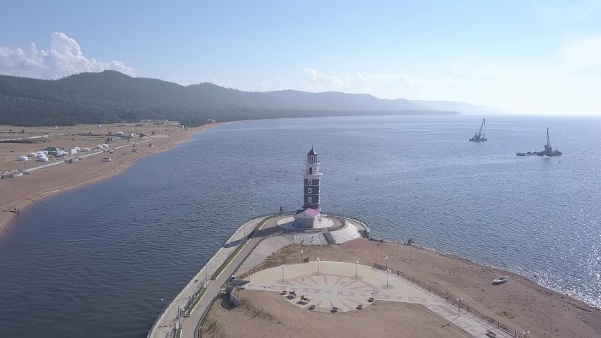 D-Cinelike. Russia, Lake Baikal. The lighthouse on the shore of the lake. Mouth of the river Turk, Aerial View