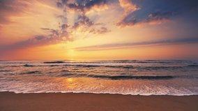 Dramatic sea sunrise. Burning sky and shining golden waves.