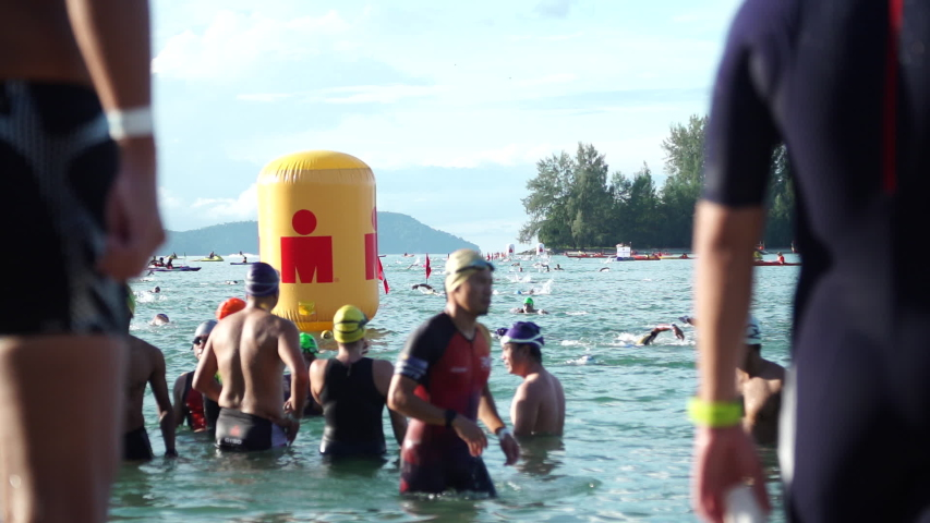 Langkawi, Malaysia - Circa 2019 : B-Roll shots of Triathlon Athletes Swimming during Ironman Swimming Stage