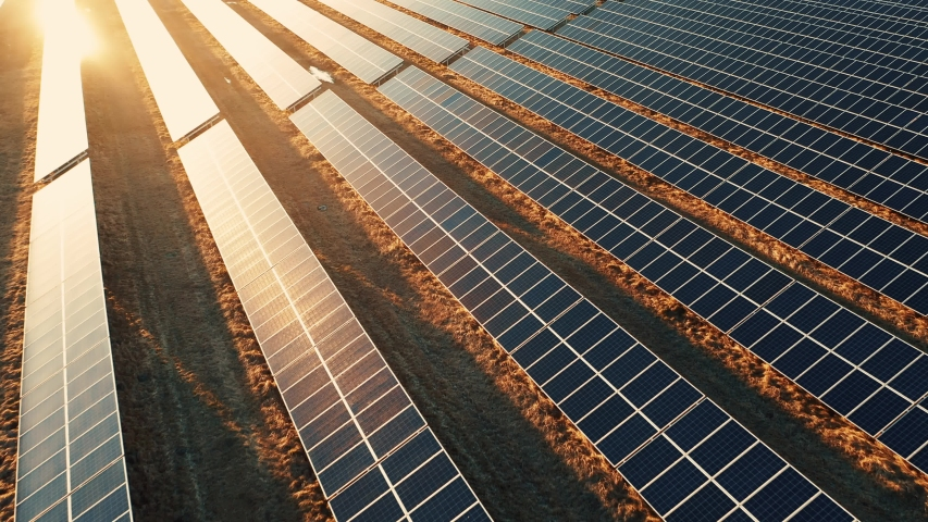 Close up solar power station panels in a row in the fields green energy at sunset landscape electrical ecology innovation nature environment slow motion | Shutterstock HD Video #1053615401
