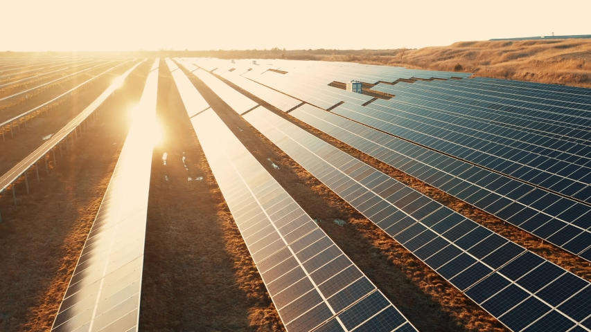 Ecology solar power station panels in the fields green energy at sunset landscape electrical innovation nature environment slow motion