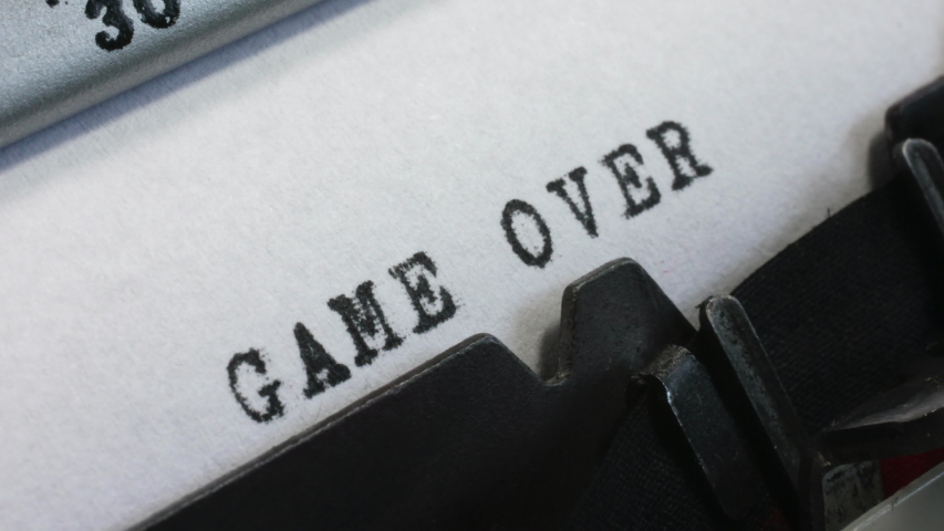 Typing Game Over on an old manual typewriter. The end of a game, sport or other activity. | Shutterstock HD Video #1053615434