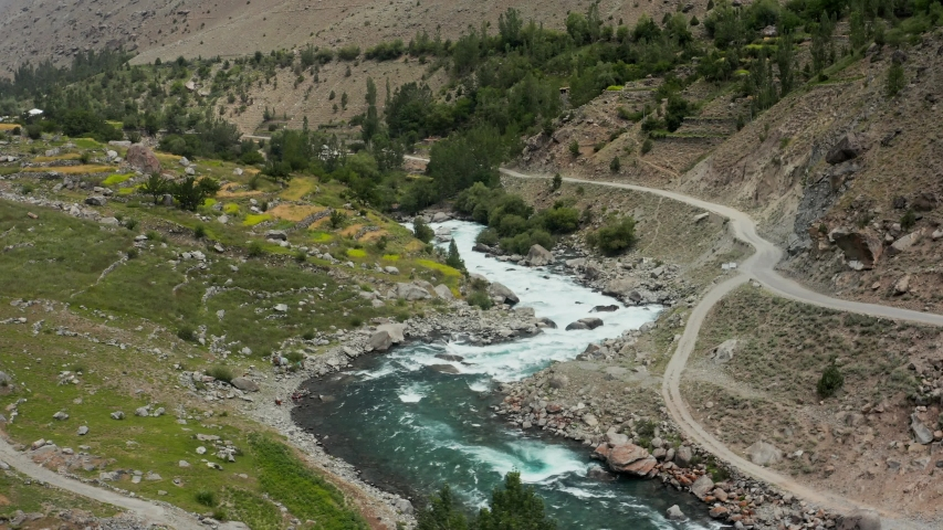 Aerial view of a wild blue river in rocky mountains in Astore Valley, Pakistan