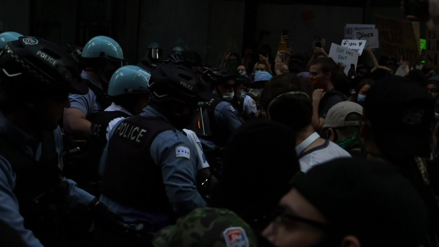 Chicago, IL / United States - May 31, 2020: Tensions rise on Adams Street, officers create a buffer zone to reach the intersection. Protesters we4re ultimately successful and reached the intersection