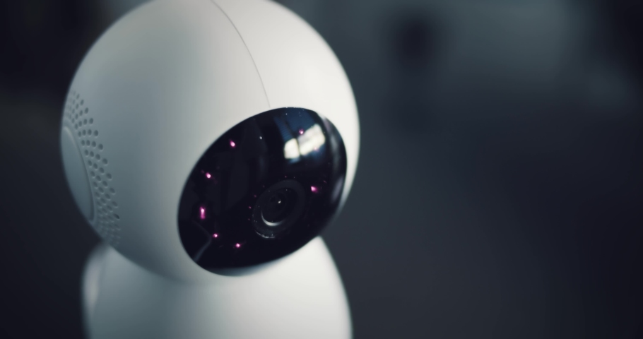 Robot home futuristic security camera scans the surroundings. Digital HUD overlay. Royalty-Free Stock Footage #1053622133
