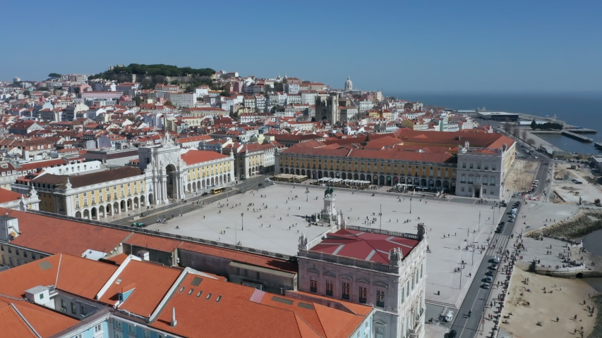 Wide Aerial Drone Shot of the Lisbon Cityscape and the Parco do Comercio, Portugal | Shutterstock HD Video #1053623357