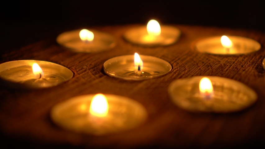 Candles blown out on wooden worktop, shallow depth of field | Shutterstock HD Video #1053624947