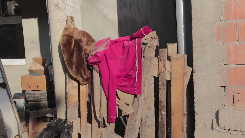 Clothes hanging in poor area of Romania | Shutterstock HD Video #1053624980