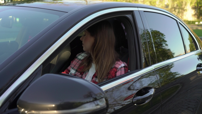 Young woman car driver in traffic jam, nervous girl in automobile. Luxury auto road collapse or traffic accident | Shutterstock HD Video #1053626198