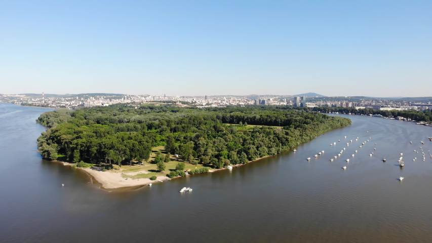 Drone video of Lido beach on the northern tip of the Great War Island on river Danube in Zemun, Belgrade, Serbia | Shutterstock HD Video #1053627770