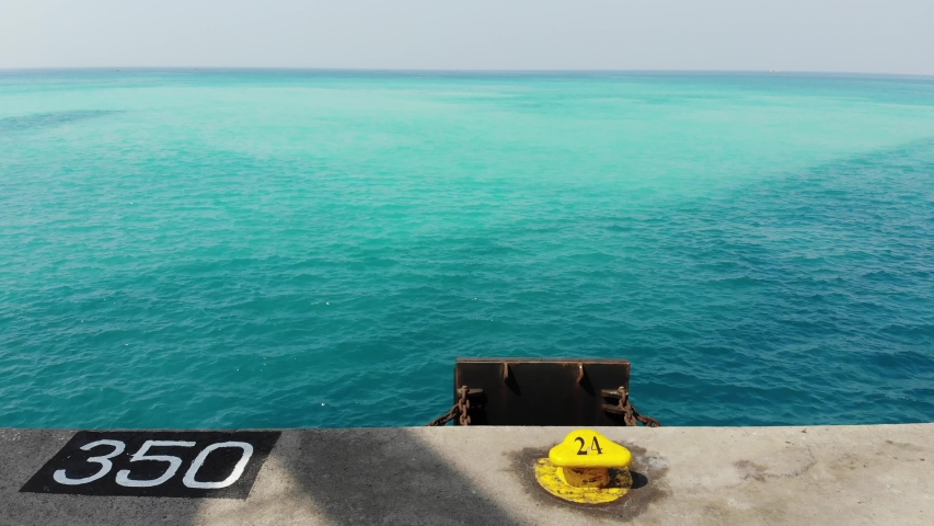 Drone shot of blue green water from the seaport