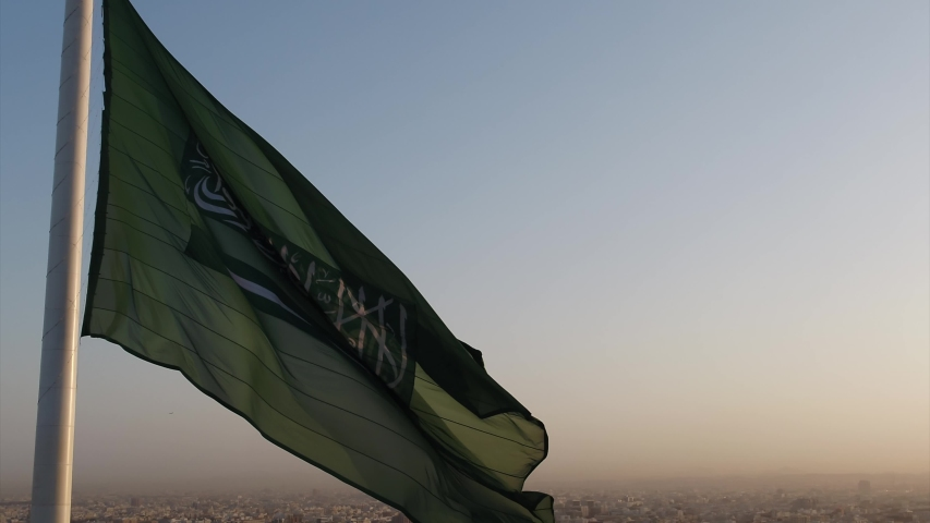 Drone shot of the Saudi Arabia flag at the roundabout during the evening