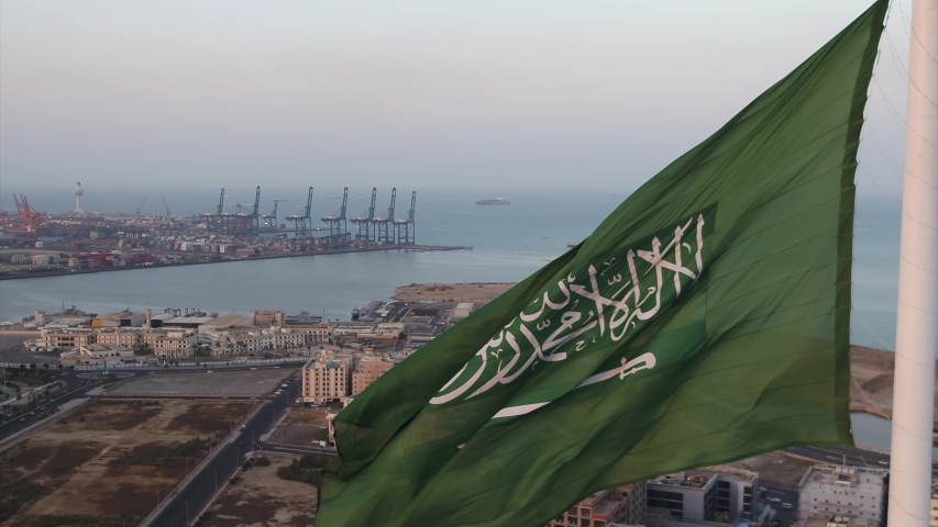 Beautiful drone shot of the Saudi Arabian flag hoisted at the famous roundabout
