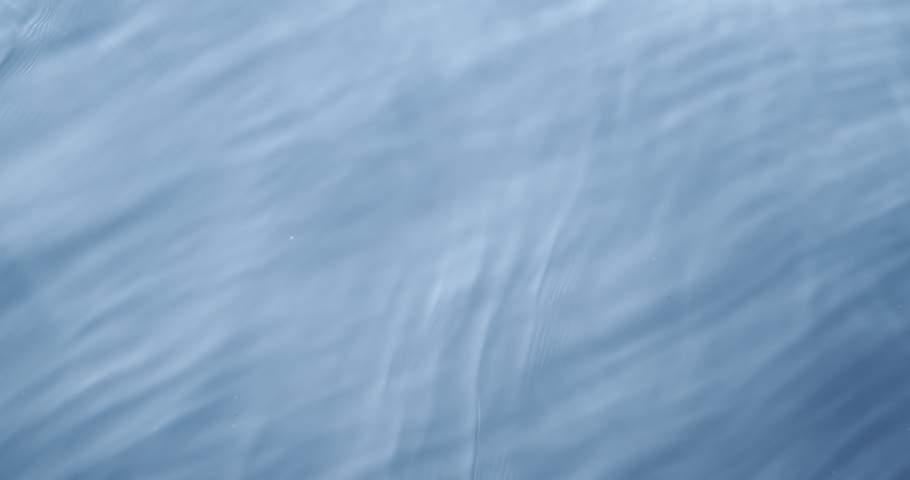 The texture of the water. blue cold water. beautiful waves top view, background