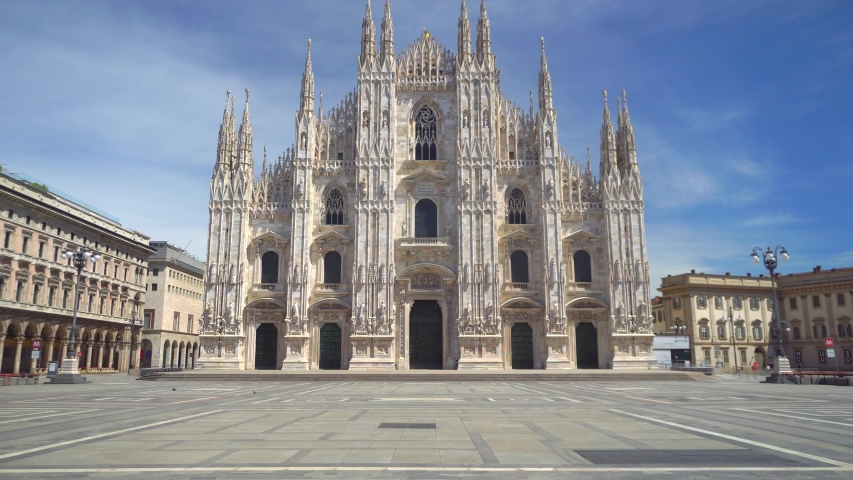 Milan, Italy - May, 2020: empty square in front of the Piazza Duomo in Italy. Empty streets. City of the desert. Gallery Columns. Blue sky