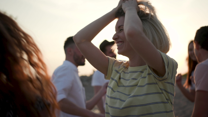 Happy Laughter Joyful 30s Female Listen Music and Dance in Summer Sunshine. Multi Ethnic Group Young Girls and Guys Arms Raised Enjoy Nature Outdoor. Happiness Life People Energy 4k Slow Motion Shot