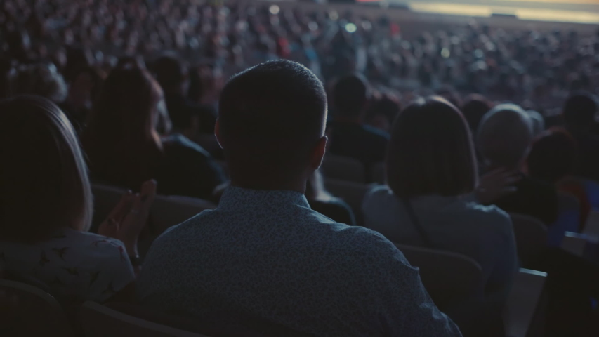Modern Public Women and Males Listening and Applauding Speaker and Discuss Information in Large Classroom. Humans Company Enjoy on Musical Concert. Background Contemporary Learn Partnership Occupation Royalty-Free Stock Footage #1053652910