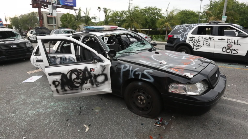 Los Angeles, California / USA - May 30, 2020: A police vehicle stands ruined after protestors destroyed it during the George Floyd Protests.